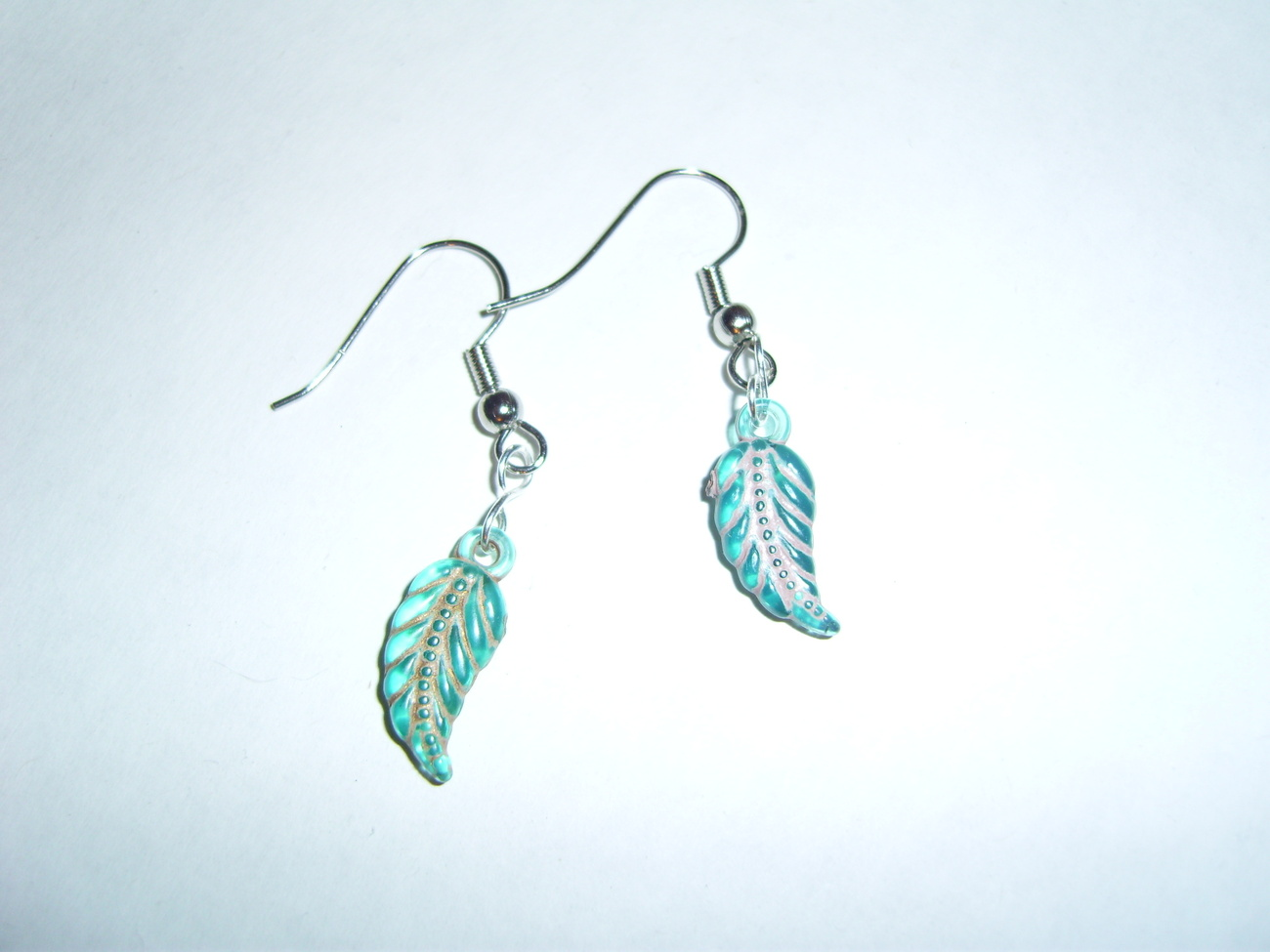 Handmade blue beaded leaf earrings
