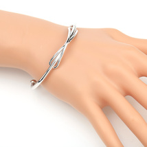 UE-Trendy Silver Tone Designer Bangle Bracelet With Contemporary Infinit... - $13.99