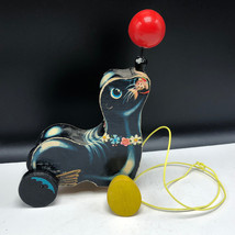 VINTAGE FISHER PRICE PULL TOY usa made seal otter sea lion ball nose whe... - $57.42