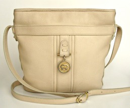 Vintage Aigner cream colored leather shoulder purse. Pockets, zipper closure.  - $12.95