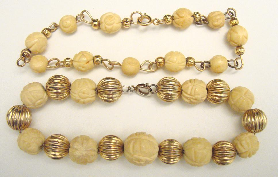 TWO VINTAGE CARVED BONE BRACELETS