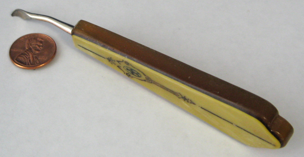 Antique Celluloid Cuticle Tool 2 Tone Embossed Fleur de Lis