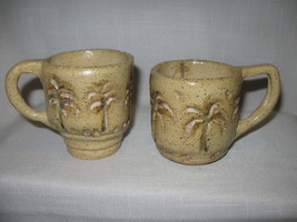 Potter Coffee Mugs Beige with Palm Tree Designs... - $9.99