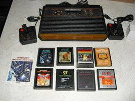 Atari 2600 4 SWITCH with joysticks, adapter, 8 GAMES  space invaders, asteroids - $148.49