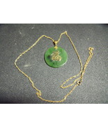 Jade Disc Goldtone pendant and chain - $75.00
