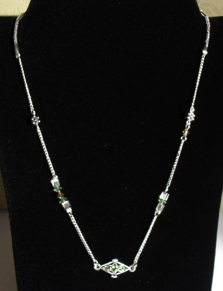 Unique abstract Silver, Peridot and Light Brown Topaz Swarov