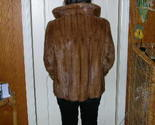 Bakc of mink coat thumb155 crop