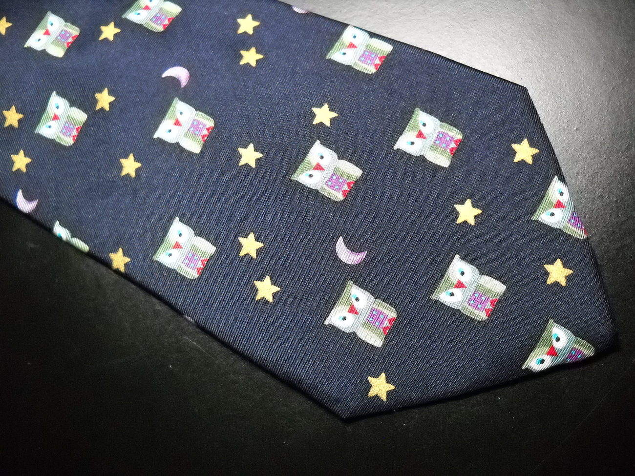 Alynn Neckwear Neck Tie Dark Blue with Repeating Night Owls in Greens Reds Blues
