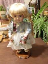 Geppeddo Blonde Girl with Braids Porcelain Doll - $15.00