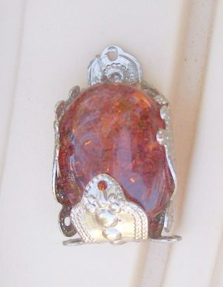 large resin amber bead wrapped for a pendaNT