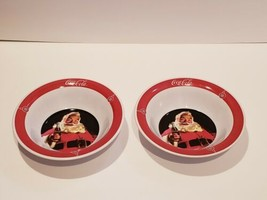 Set of 2 Gibson Coca Cola Collectible Plastic Bowls with Santa holding b... - $5.87