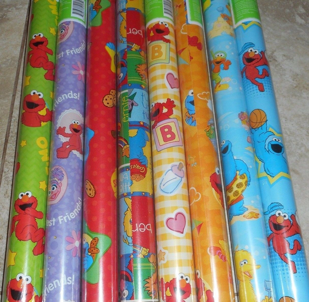 elmo wrapping paper This pin was discovered by becky wilson discover (and save) your own pins on pinterest.
