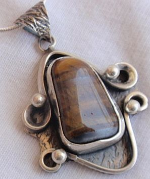 Brown colored silver pendant