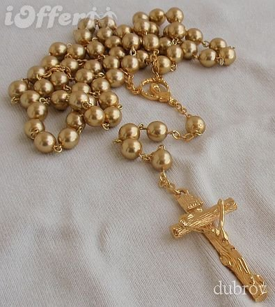 A beautiful golden pearl rosary