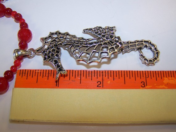 Sea Horse Bliss-mother of pearl with faceted jade 24 inch ne