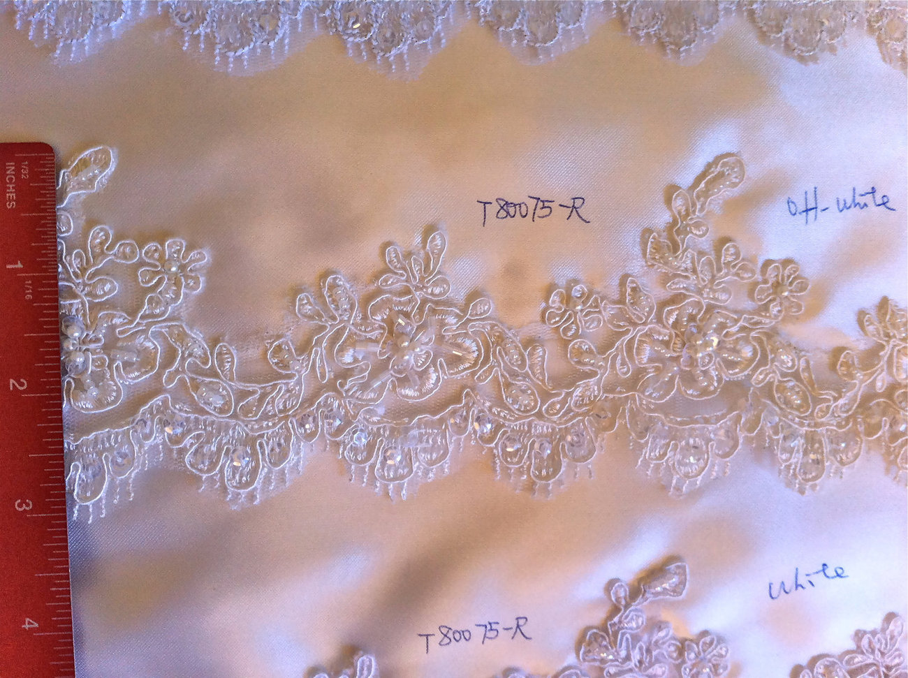 "Ivory  Alencon trim lace,  beaded with sequences  2.5"" width"