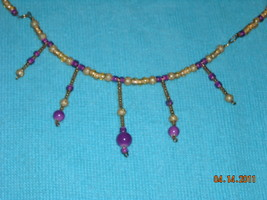 purple,gold,and pink beaded necklace - $19.00
