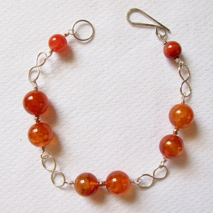 Sterling Silver and Carnelian Bracelet with Infinity Links