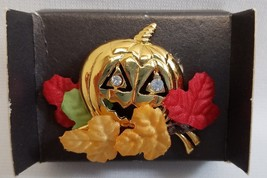 1993 Avon Brooch Pin Rhinestone Eyes Golden Fall Pumpkin Jack O Lantern - $11.30