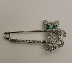 Vintage silver tone rhinestone cat w/ green eyes safety pin brooch - $34.60