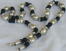 A silver necklace with onyx stones 2 thumb200