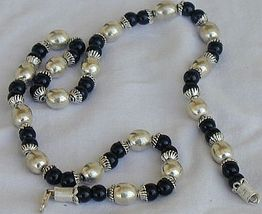 A silver necklace with onyx stones 3 thumb200
