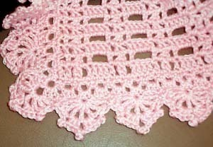 Handmade baby blanket afghan or lapghan: warm pink, 35x44, washable