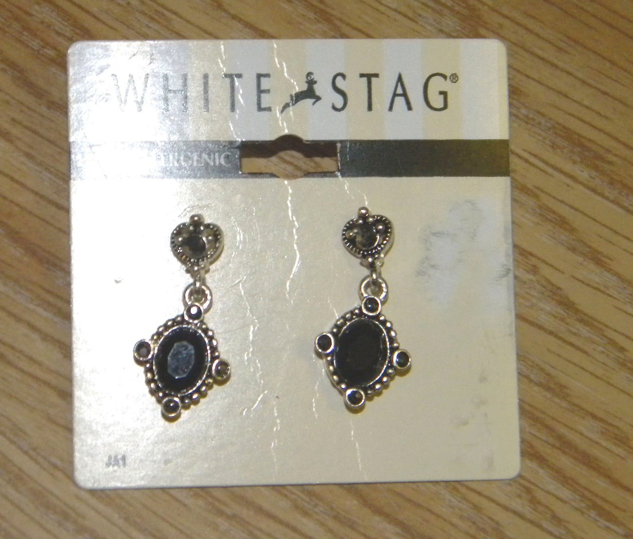 1 silver tone white stag earrings