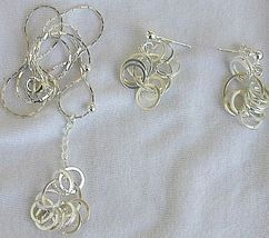 Silver rounds necklace with earrings - $40.00