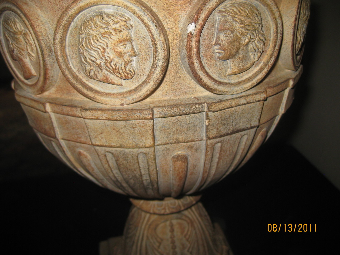 Pair of classical urn lamps with medallions