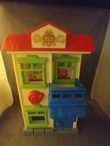 Fisher-Price Little People Firefighter and Burning Building  - $10.00
