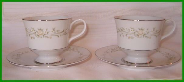 2 sango cups and saucers