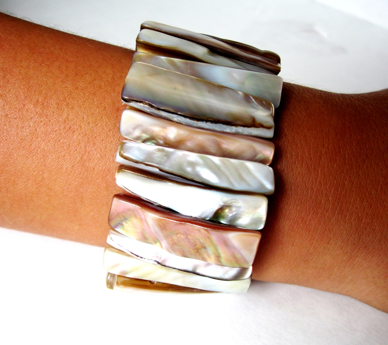 Free Stretch Cuff Shell Bracelet with Every Handbag Purchase Natural Color