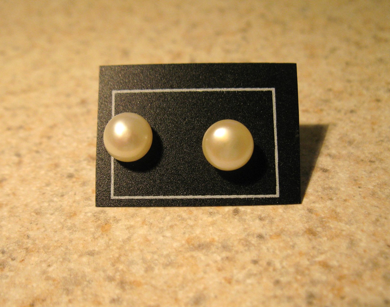 276 white pearl studs