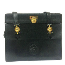 Vintage Gianni Versace black leather tote bag with golden sunburst motif... - $432.00