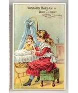 Wistar's balsam Wild Cherry Victorian trade card baby doll girl cradle m... - $12.00