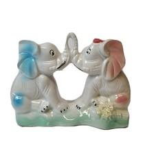 Vintage Elephants Kissing Trunks Iridescent finish Made in Brazil Figurine  - $13.85