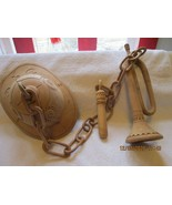 """Balsa wood Pith helmet with trumpet and baton wall hanging, wood chain, 30"""" - $50.00"""
