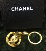 Vintage CHANEL gold tone round Sphere CC key chain with CC marks.  - $178.00