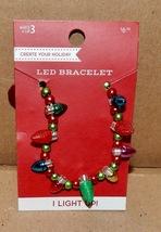 Christmas LED Bracelet Lights Up & Flashes Balls & Bulbs Holiday Fun 177M - $5.25