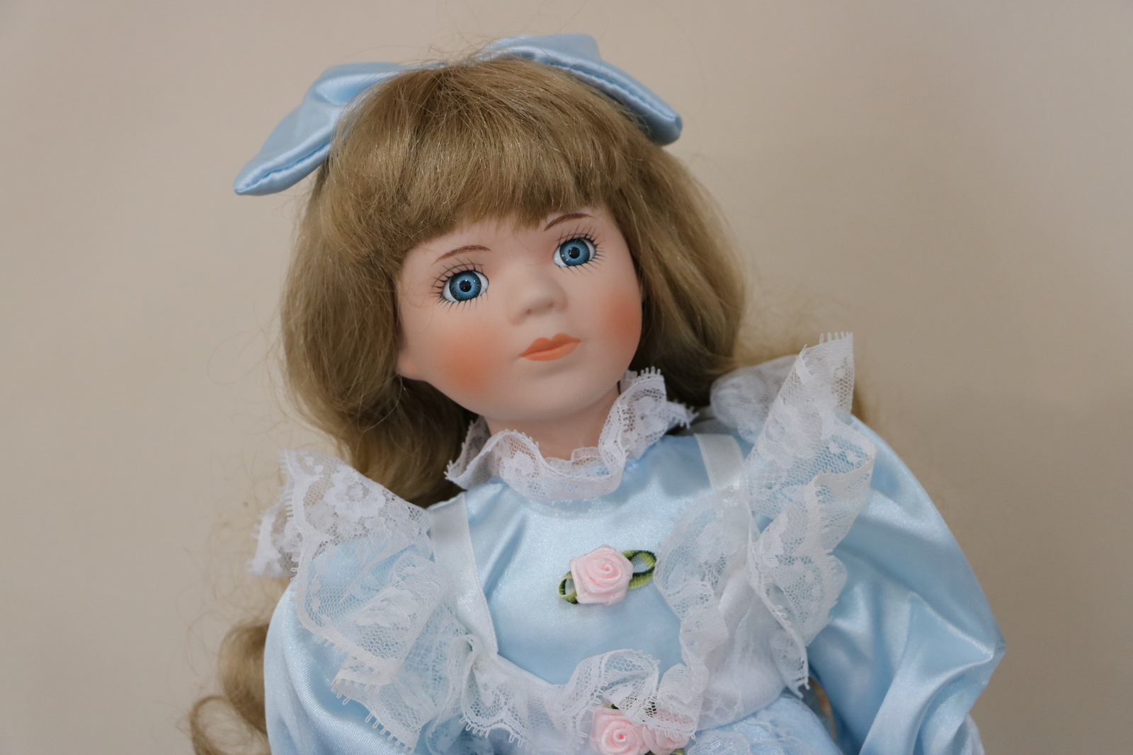 Porcelain Ceramic Doll with Long Blond hair and blue eyes wearing a Blue Dress image 2