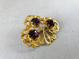 Vintage golden brooch with purple crystals Vintage purple rhinestones br... - $25.00