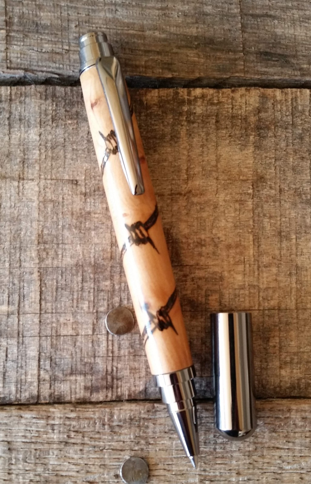 Ndmade wood pen with japanese loquat and barbed wire pyrography on gun metal rollerball fittings