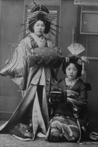 Two Young Beautiful Japanese Geishas accoutered in the ceremonial costumes and h - $19.99+
