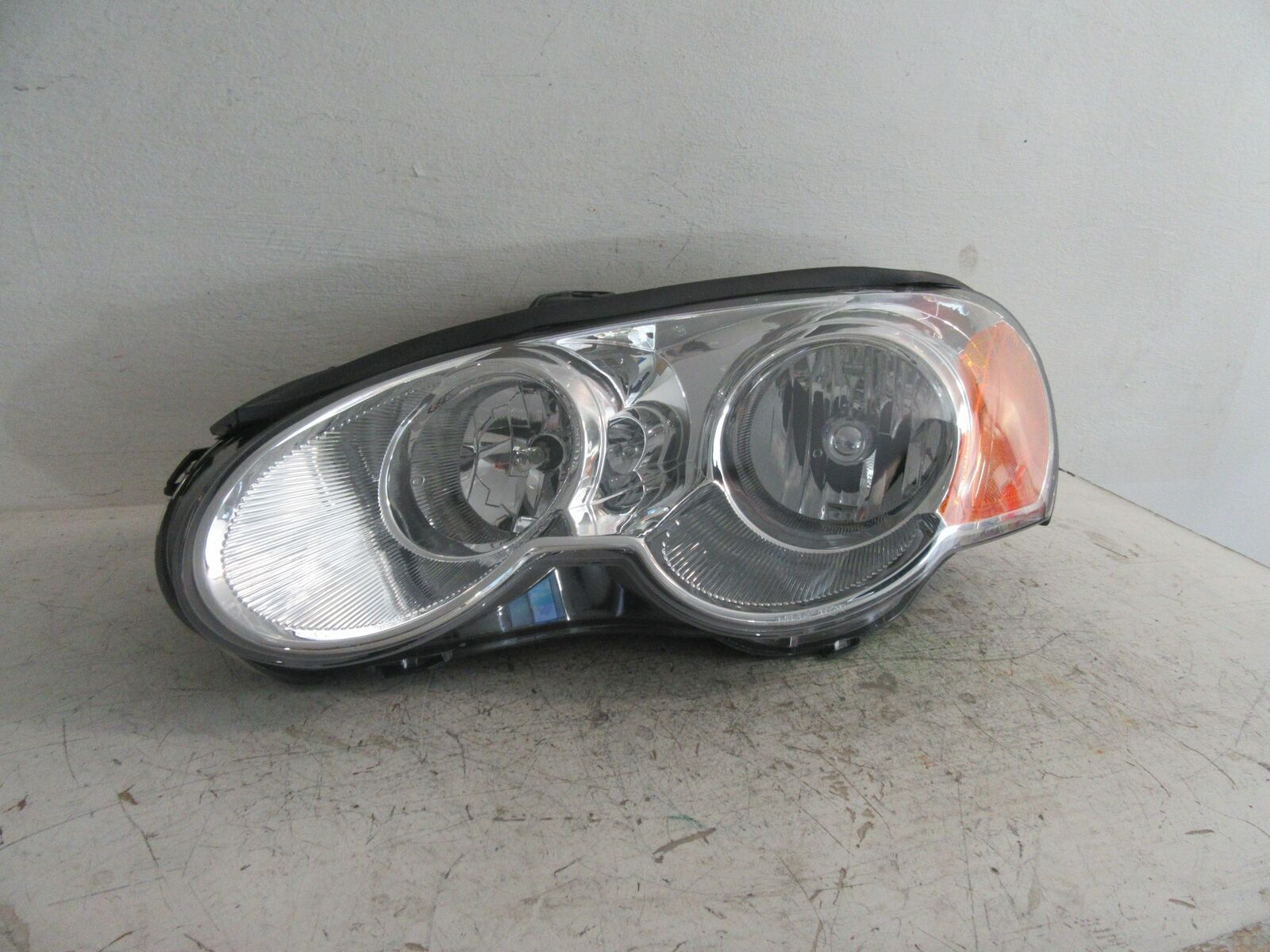 Primary image for 2003 2004 2005 FITS CHRYSLER SEBRING LH DRIVER HEADLIGHT TYC 43