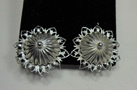 Coro Silver Tone Domed Floral Clip On Earrings - $9.89