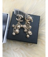 NIB 100% AUTH Chanel 12A CC Bell Drop Earring In Light Gold - $691.02