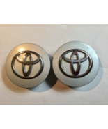 TWO (2) USED TOYOTA SILVER CHROME EMBLEM CENTER HUBCAPS P/N ABS PACIFIC CAR PART - $12.92