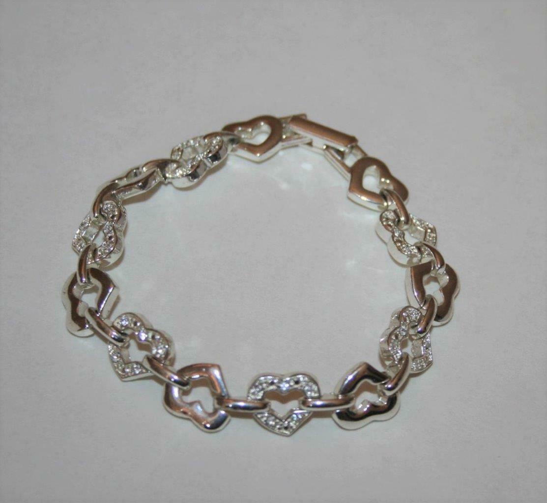 Avon Silvertone Crystal Open Heart Bracelet  J345