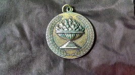 Olympic coin with torch Cauldron and -Laurel leaves    - $44.55